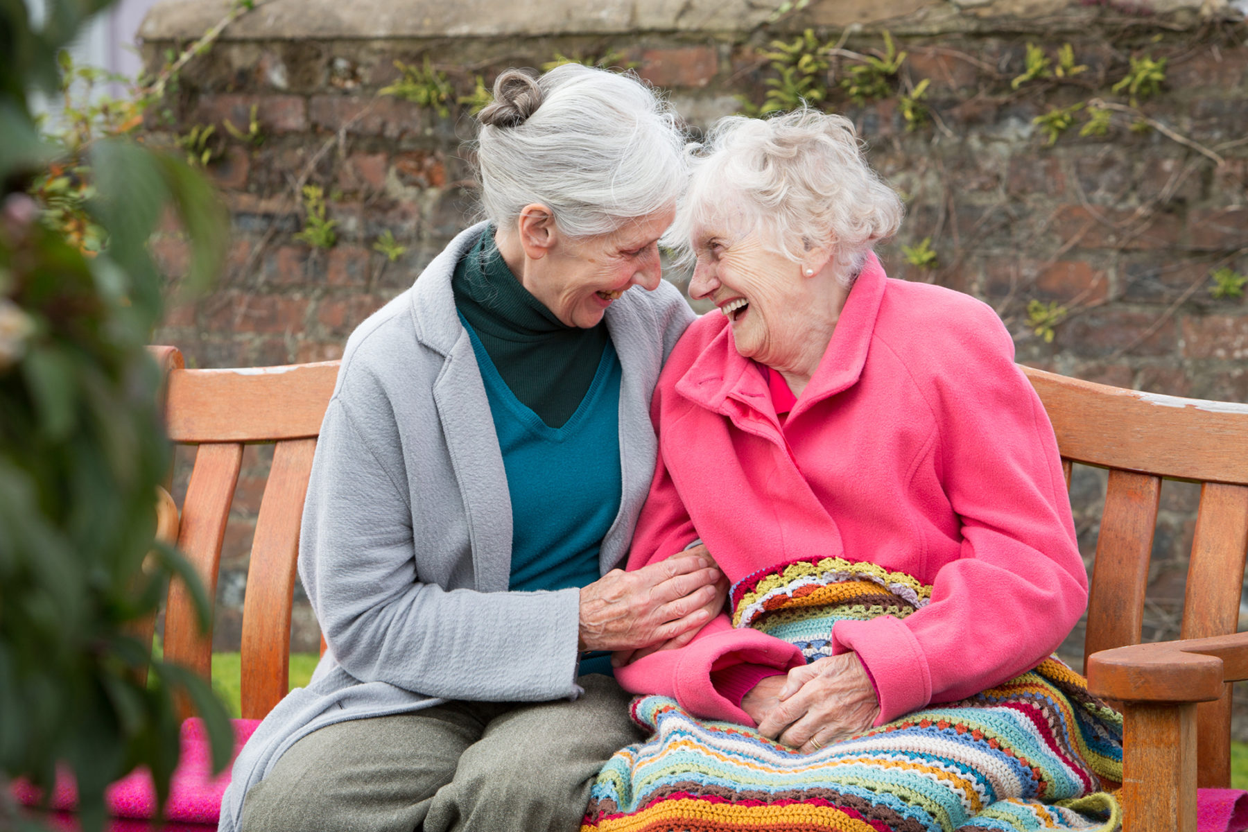 Spearhead Healthcare, portrait of two elder women sitting on a bench | by McAteer Photograph