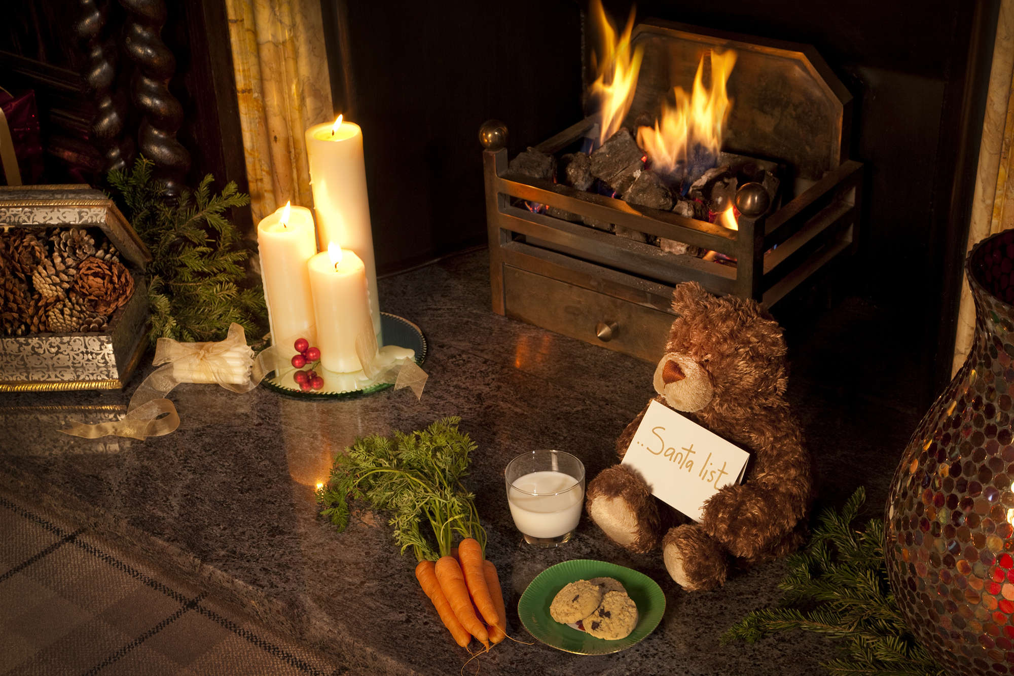 Bear with Santa's list and a cosy fire place
