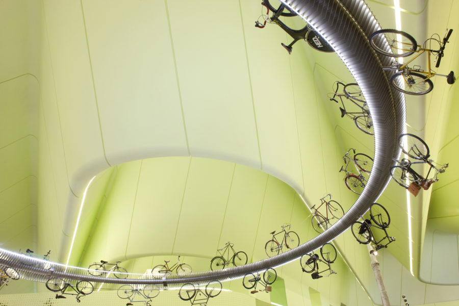 Cycling track with bikes in mid-air | by McAteer Photograph