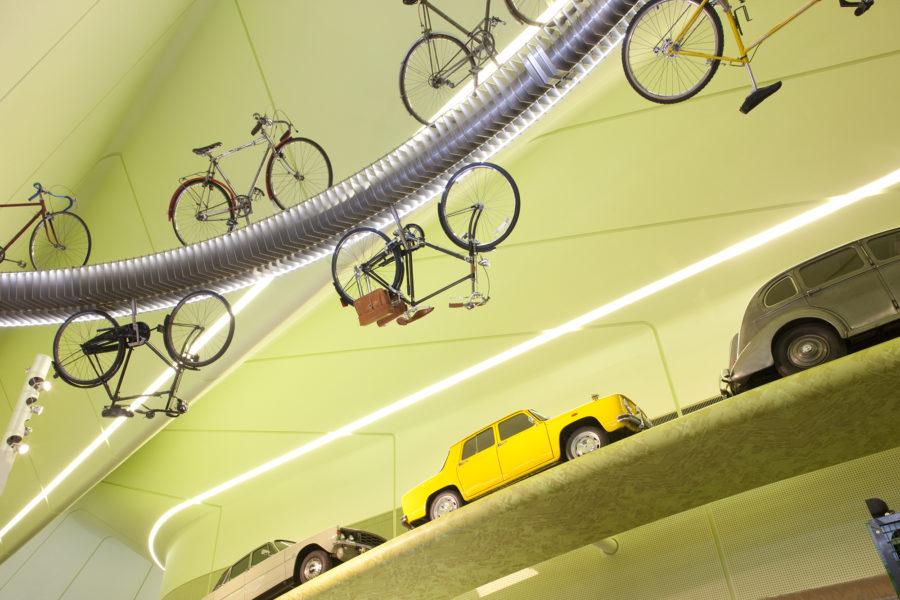Cycling track with bikes in mid-air and cars | by McAteer Photograph