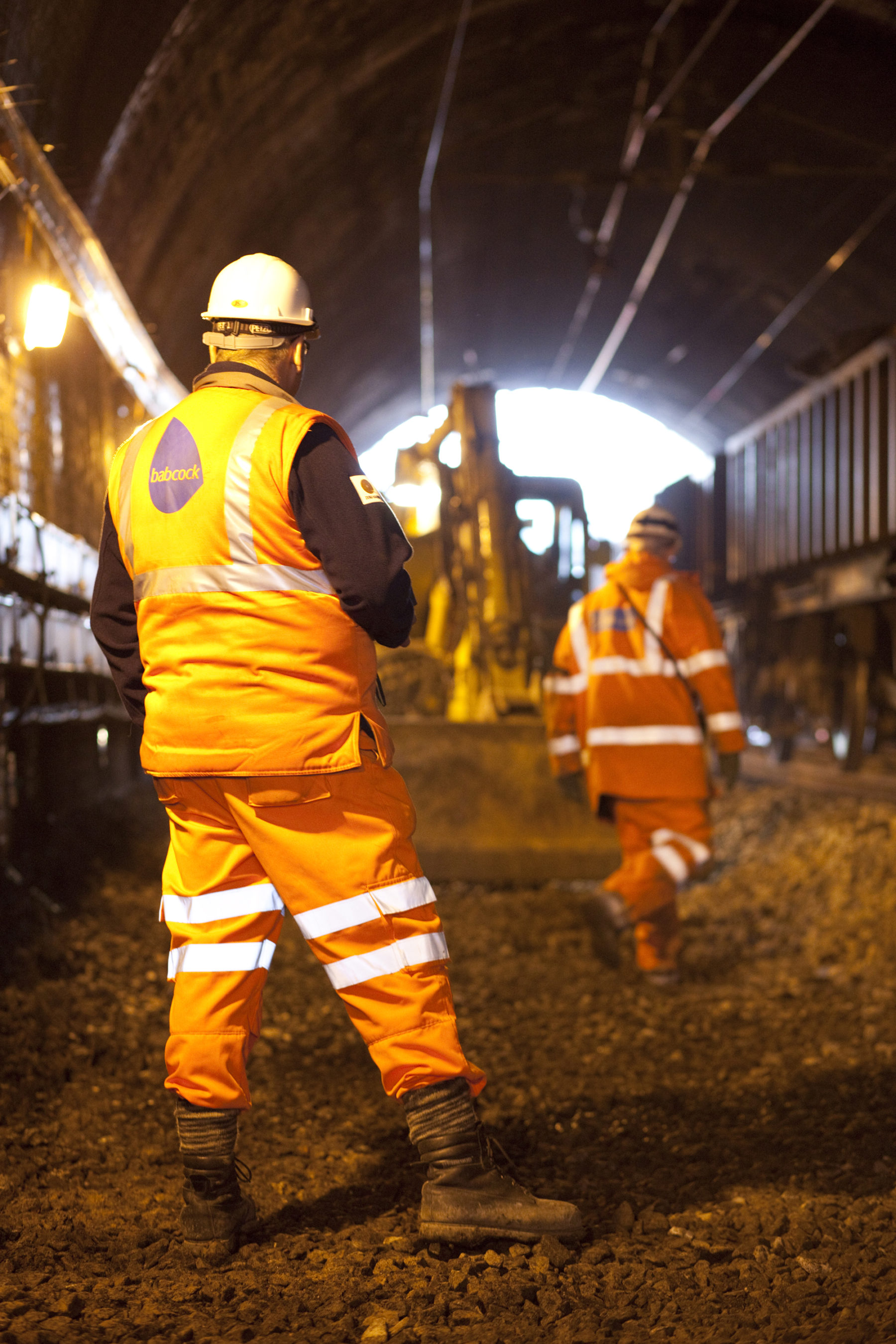 Engineer and contractor planning railway repairs