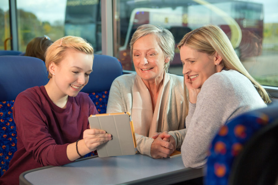 Daughter, mother and granny looking at Ipad on a coach, Stagecoach, Megabus | by McAteer Photograph