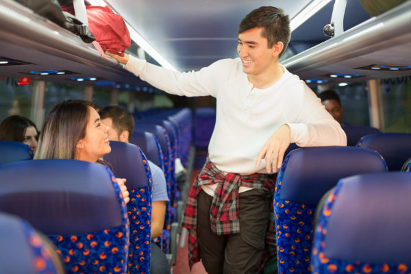 Young man walking through coach, Stagecoach, Megabus | by McAteer Photograph