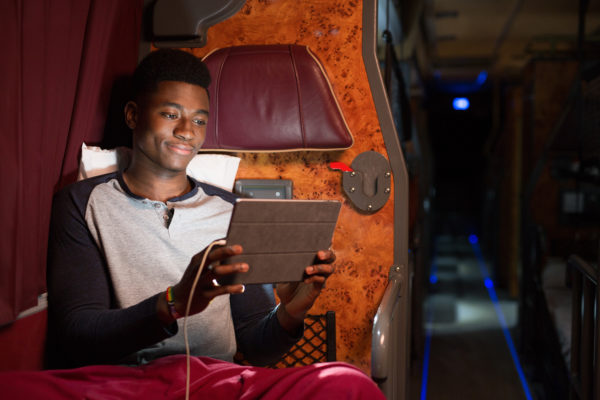 Young man on iPad in sleeper coach, Stagecoach, Megabus | by McAteer Photograph