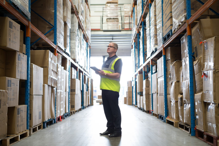 Spearhead Healthcare, portrait of man inside the Warehouse & storage| by McAteer Photograph