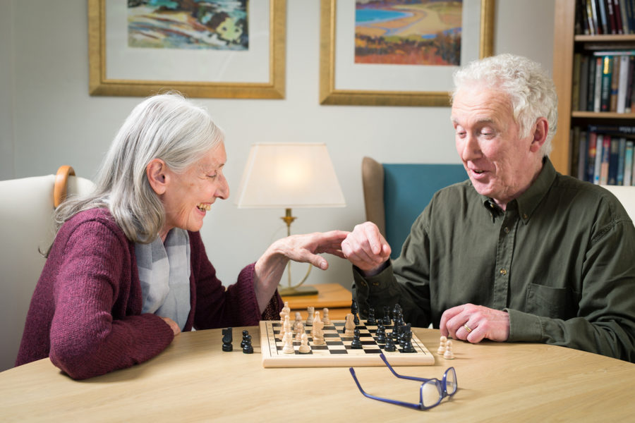 Spearhead Healthcare, portrait of two elder people playing chess | by McAteer Photograph