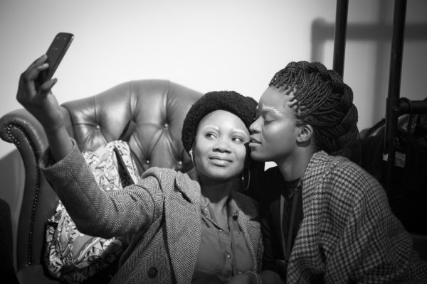 Two women making a selfie, Backstage, Fashion show | by McAteer Photograph