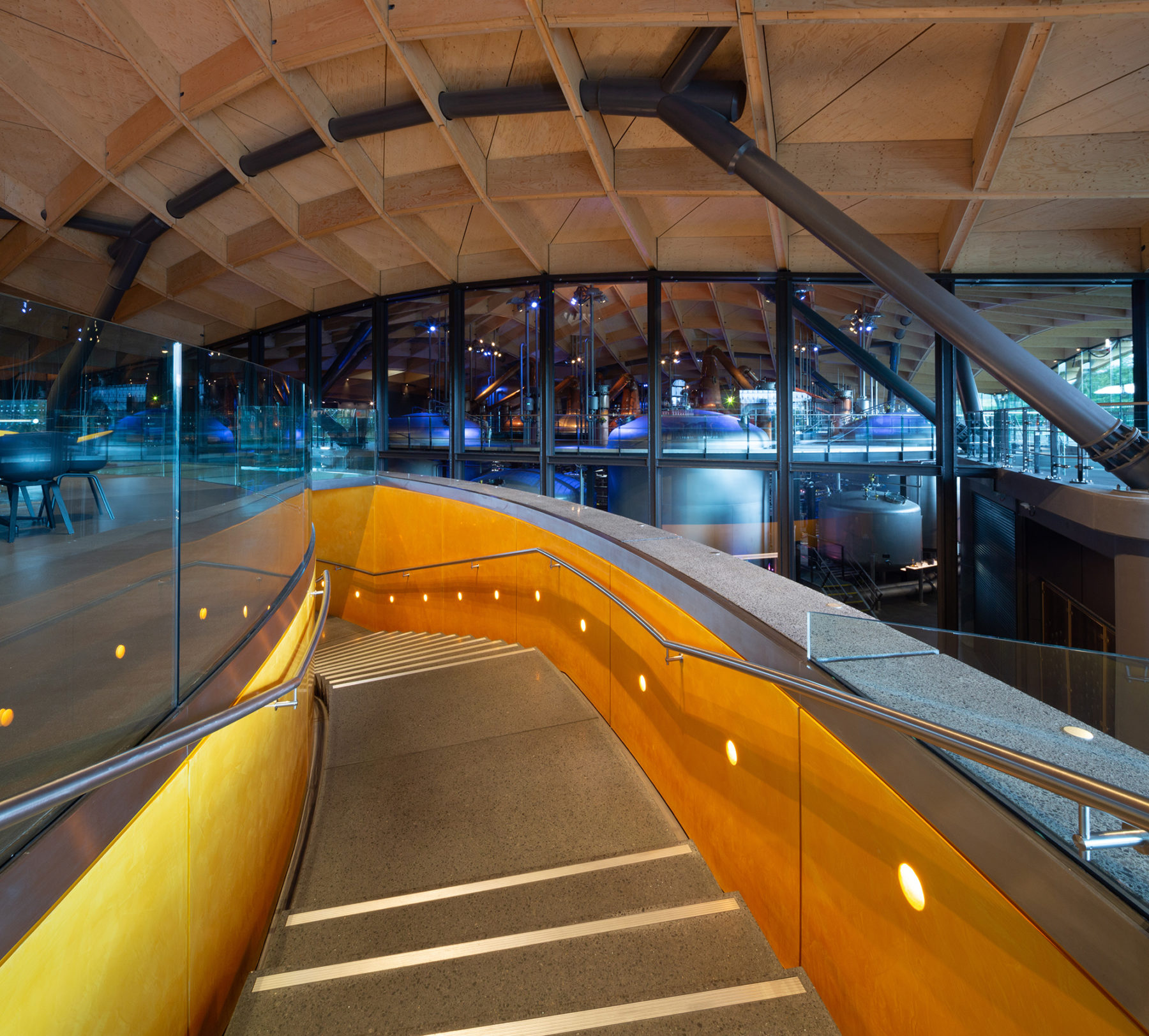Stairs to the upper bar area with a view towards the production facilities, Macallan distillery | by McAteer Photograph
