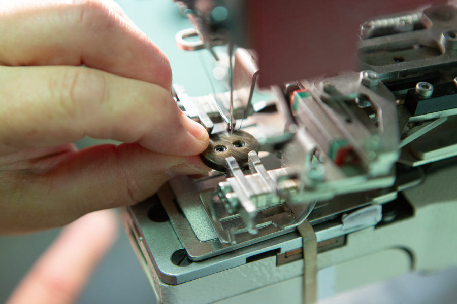 Sewing buttons on | By McAteer Photo