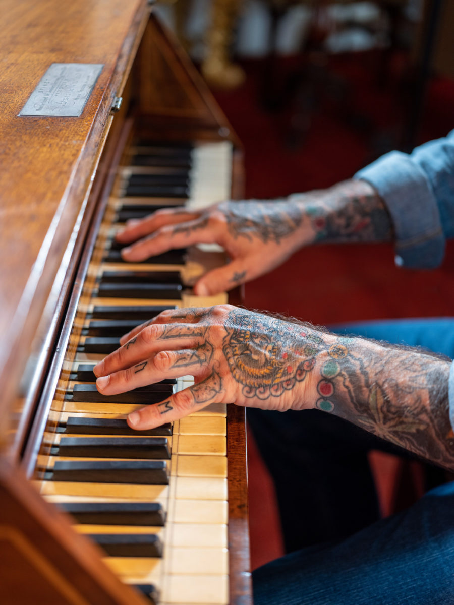 Man playing on a spinet | Image by McAteer Photo