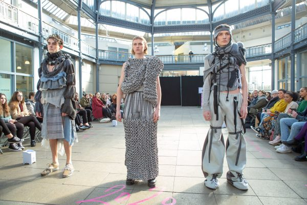 Three models on the catwalk. The event is the Glasgow School of Art's second and third year Fashion Design and Textiles show at the Briggait in Glasgow's Saltmarket district. | Images by mcAteer Photo